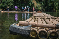 Wooden bamboo raft on river crossing in Yangshuo