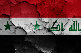 flags of Syria and Iraq painted on cracked wall