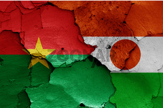 flags of Burkina Faso and Niger painted on cracked wall