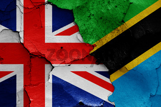 flags of UK and Tanzania painted on cracked wall