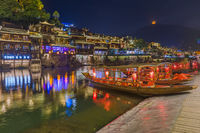 Fenghuang, China - May 29, 2018: Ancient town Fenghuang at sunset in Hunan