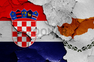 flags of Croatia and Cyprus painted on cracked wall