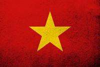 The Socialist Republic of Vietnam National flag. Grunge background