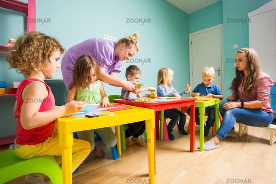The preschool students with a tutor activities in art class