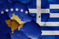 flags of Kosovo and Greece painted on cracked wall