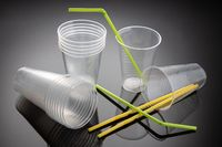 Set of new empty Plastic cups and straws