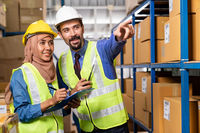 Warehouse manager and muslim worker working inventory