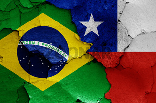 flags of Brazil and Chile painted on cracked wall