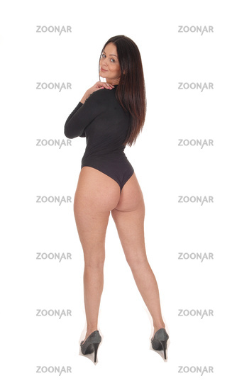 Woman standing from back in black body suit