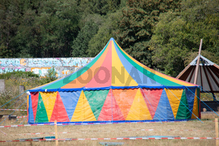 colorful circus tent in the park with tension cables
