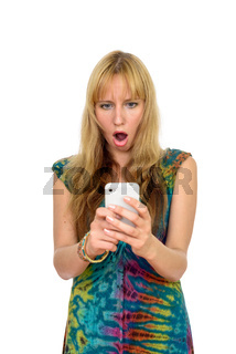 Portrait of beautiful blonde woman using phone and looking shocked
