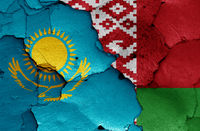 flags of Kazakhstan and Belarus painted on cracked wall
