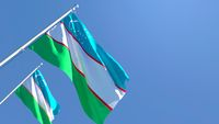 3D rendering of the national flag of Uzbekistan waving in the wind