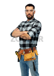 happy male worker or builder with crossed arms