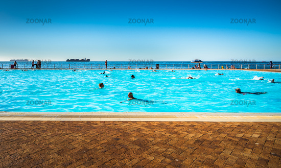 Cape Town, South Africa - February 4, 2019: The Sea Point open public pool on the waterfront of Cape Town, South Africa.