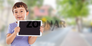 Boy child holding tablet computer town banner copyspace copy space information marketing ad advertising