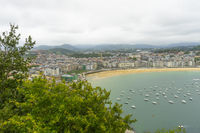 Holiday, view of the city of San Sebastian, with La Concha beach, from Mount Urgull. Summer vacation scene in Spain