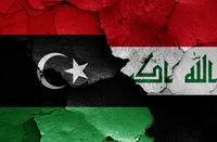 flags of Libya and Iraq painted on cracked wall