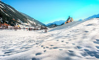 Mountain landscape, picturesque snow footprints in the winter morning panoramic church