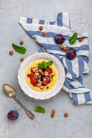 Millet porridge with caramelized plum and hazelnuts.