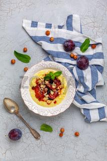 Millet porridge with caramelized plum and hazelnuts.