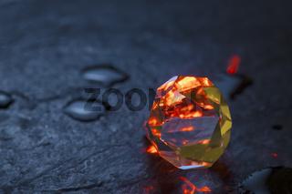 Cut crystal red illuminated on blue slate