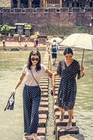 People on stepping stones in Fenghuang