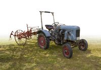historic tractor with agricultural device