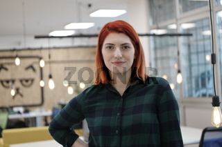 redhead woman at work  in creative modern coworking startup open space office