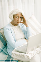 Gray haired senior woman with laptop