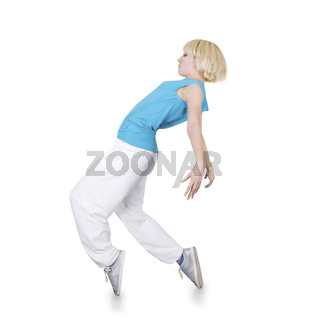 Teenage girl dancing hip-hop over white background