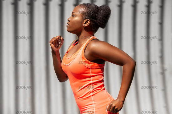 young african american woman running in tunnel