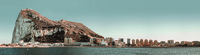 Panoramic view of Gibraltar. Residential buildings in row skyline against rocky mountain waterside view, Iberian Peninsula at entrance of the Mediterranean Sea