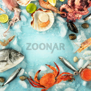 Fish and seafood square frame with a place for text on a blue background. Sea bream. shrimps, crab, sardines, squid, mussels, octopus and scallop, shot from the top