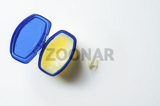 container with cream stands on a bright clean background
