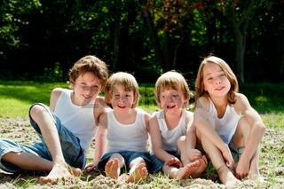 Happy children in white shirts