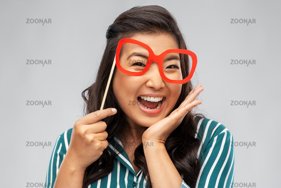 happy asian woman with big party glasses