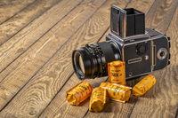 Medium format, classic film camera, Hasselblad 500 cw with rolls of film.