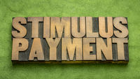 stimulus payment word abstract in wood type