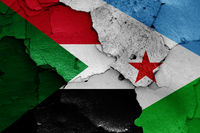 flags of Sudan and Djibouti painted on cracked wall
