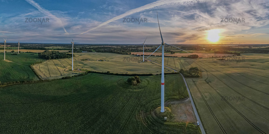 Aerial view of Wind Energy Park with cornfield landscape, at magnificent sunset, Germany, Europe.