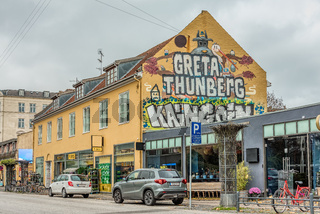 Greta Thungerg, a huge text on a wall in the city of Copenhagen