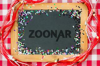 Vintage wooden blackboard with confetti
