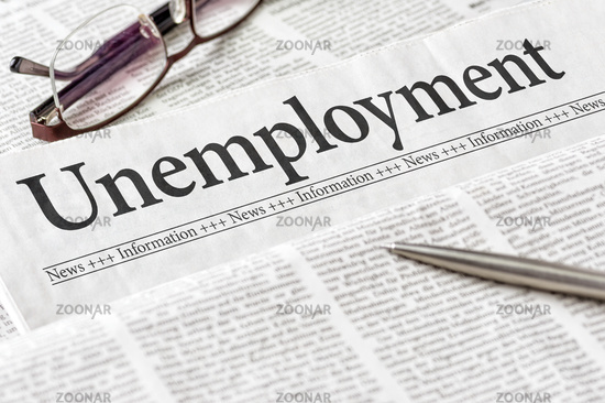 A newspaper with the headline Unemployment