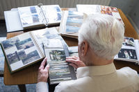 Senior man looking at photo albums.jpg