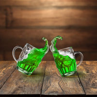 Fresh green beer splashes from two flying beer mugs.