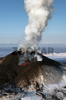 Landscape of Kamchatka: eruption volcano - effusion from the crater lava, gas, steam, ash