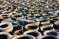tons of old used tyres in a mix