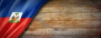 Haitian flag on vintage wood wall banner
