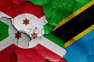 flags of Burundi and Tanzania painted on cracked wall
